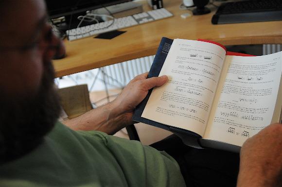 Werner Schweer reading the Behind Bars book